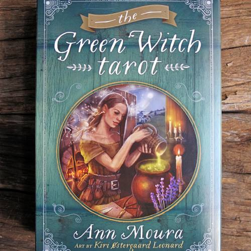 A photo of the Green Witch Tarot box, a tarot deck done by Kiri Østergaard Leonard and Ann Moura.