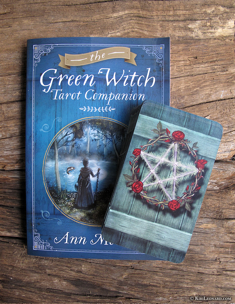 Photo of Green Witch Tarot companion book and Green Witch Tarot card deck back.
