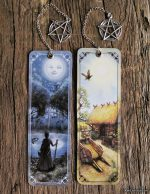 A bookmark featuring the sun and moon illustration from The Green Witch Tarot by illustrator Kiri Østergaard Leonard