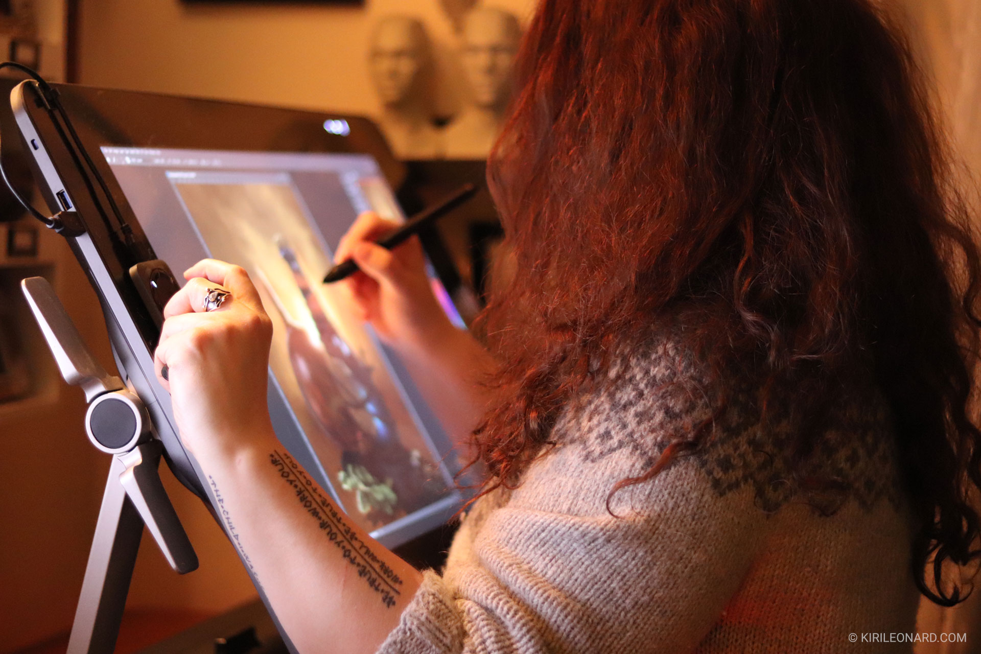 Photo of artist Kiri Leonard drawing on her Wacom Cintiq tablet